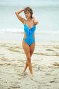 "Lisa Rinna *Bathing Suit* @ ""Garnier Beach House"" In Malibu -August 4th 2010- (HQ X9)"